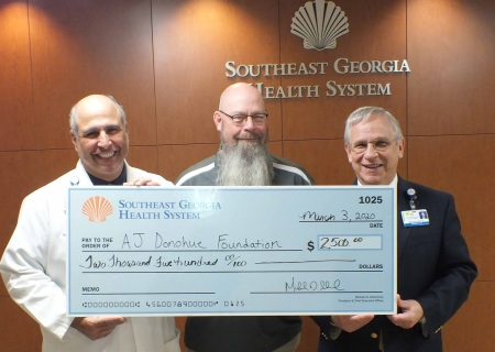 Erick Bournigal, M.D., chief, Medical Staff; Brunswick Campus; John Donohue, AJ Donohue Foundation, Inc.; and Michael D. Scherneck, president and CEO, Southeast Georgia Health System.